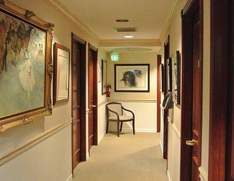 hallway leading to surgery rooms in a rhinoplasty center