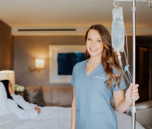 plastic surgery nurse holding a dextrose