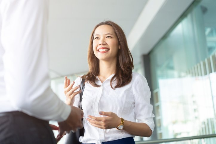 a young woman talking to a man about how to stay grounded
