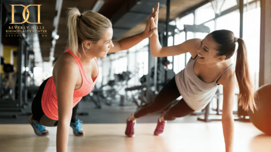 two healthy women working out in a gym