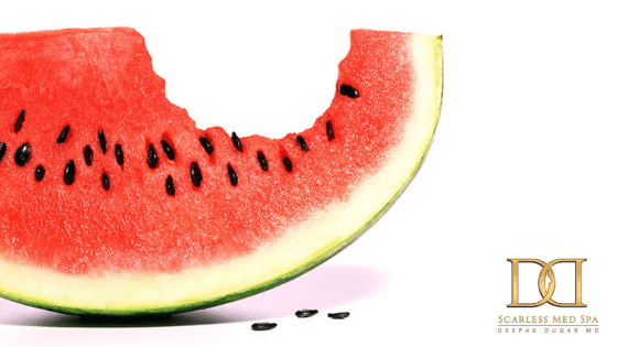 watermelon with a bite and logo of Scarless Med Spa below