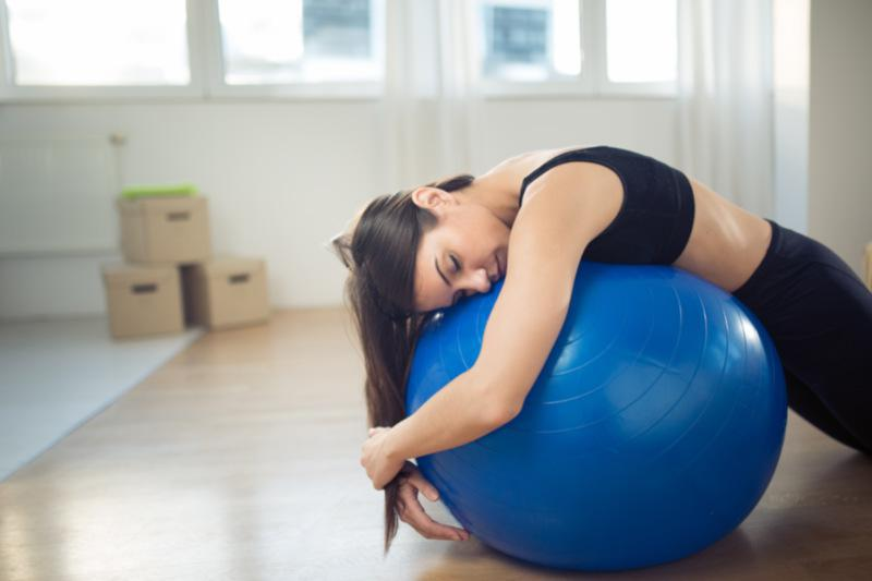 a woman doing a stability ball workout