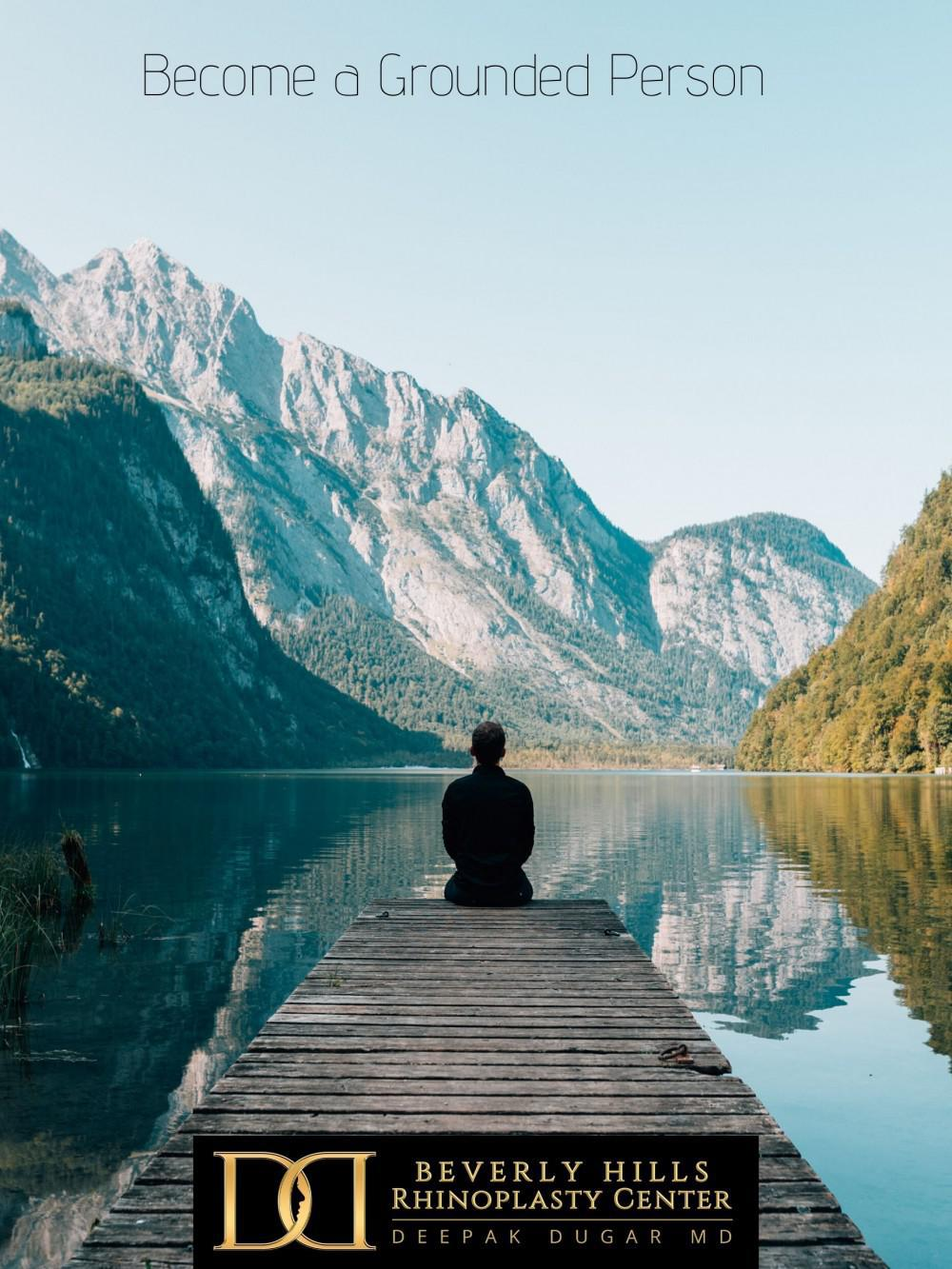 "a person sitting on a bench near a body of water and picture-perfect natural view with a text above ""become a grounded person"""