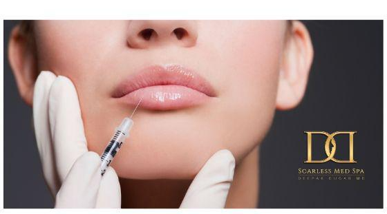 A plastic surgeon injecting hyaluronic acid based fillers to a female patient