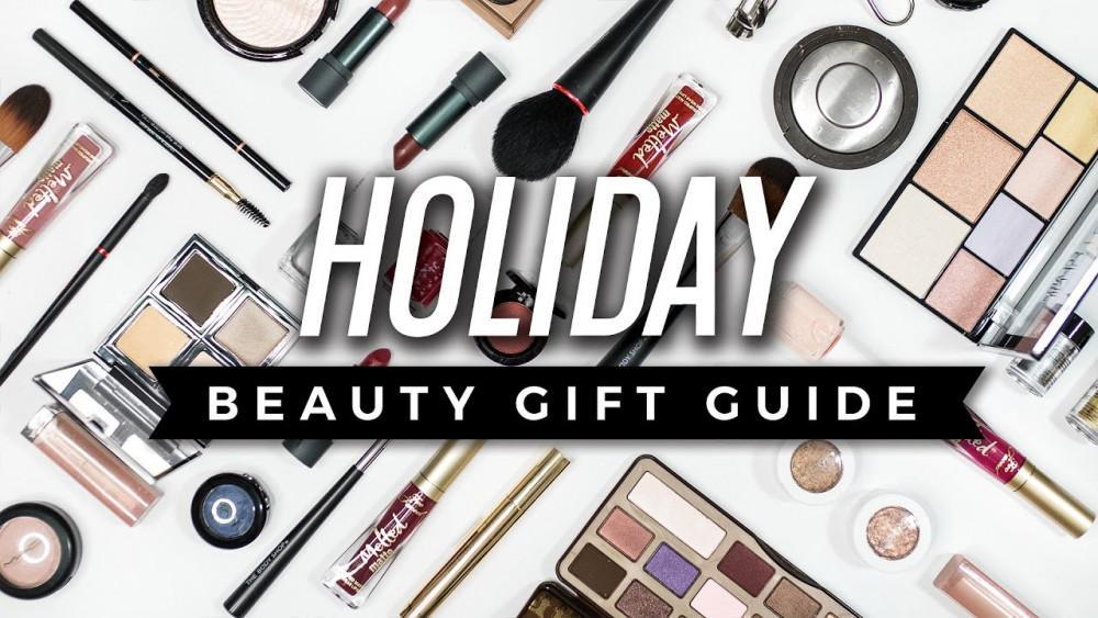 "different makeup kits as a background to the text ""HOLIDAY Beauty gift Guide"""