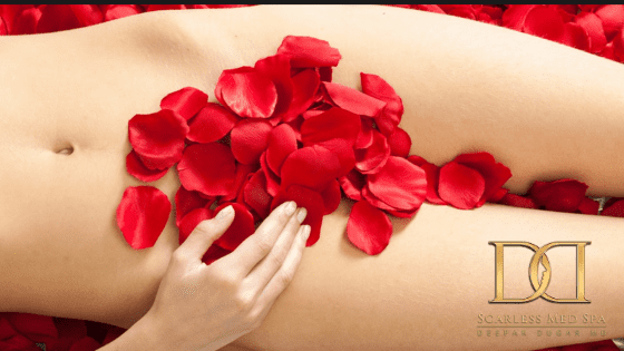 womans body covered in red petals lying on bed of roses