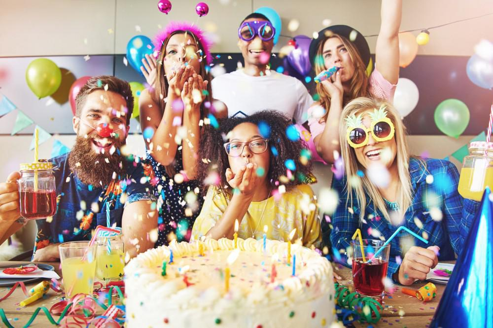 a group of friends having a perfect grown-up birthday party