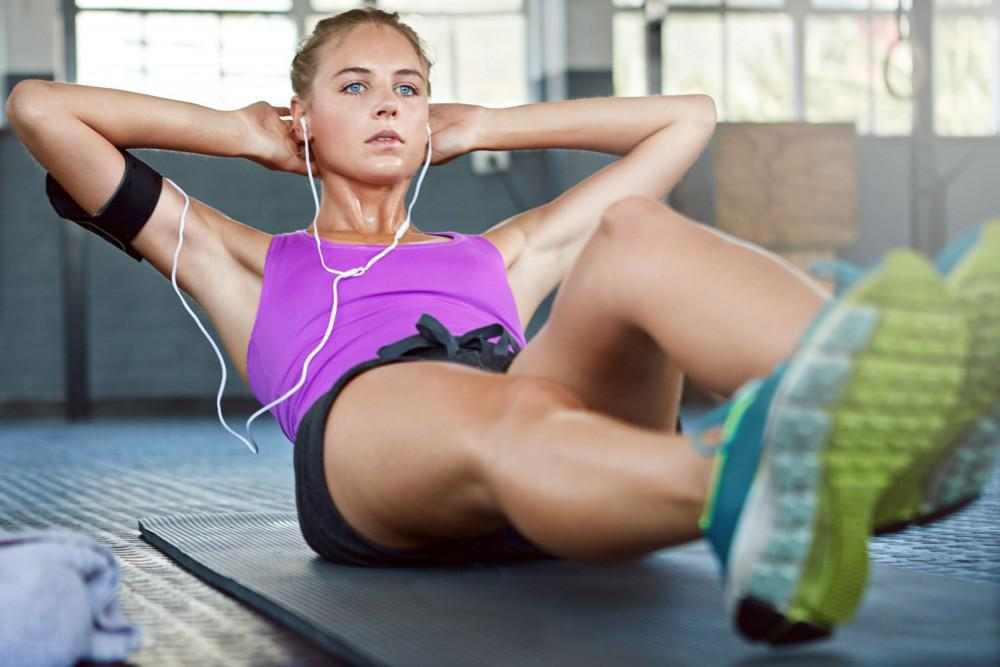a young woman doing sit ups
